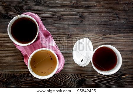 Coffee take away. Coffee cups with covers on wooden table backound top view.