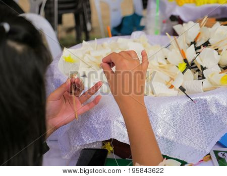 People making Thai Funeral Flower (artificial flower used for cremation) for late King Bhumibol Adulyadej cremation.