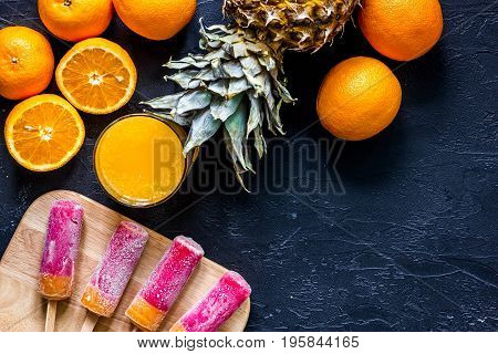 Citrus concept. Fresh fruits on black table background top view.
