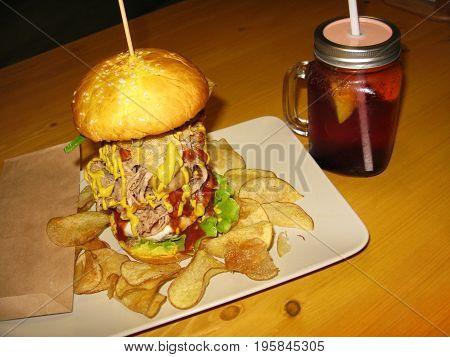 Fast food burger hamburger cherry cold lemonade drink in glass jar mug macro photo
