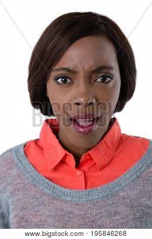 Portrait of angry young woman against white background