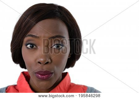Portrait of woman puckering against white background