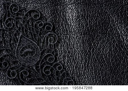 Detail of black lace on leather closeup background space for text