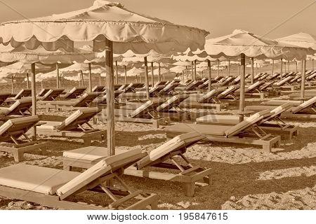 beach sunbeds and sunshades closeup of sepia tone