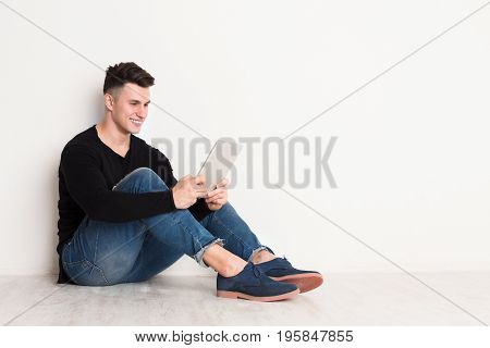 Studying online education, student with tablet sit on floor, white backgroud copy space