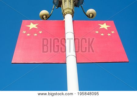 Chinese Flag On The Street Light