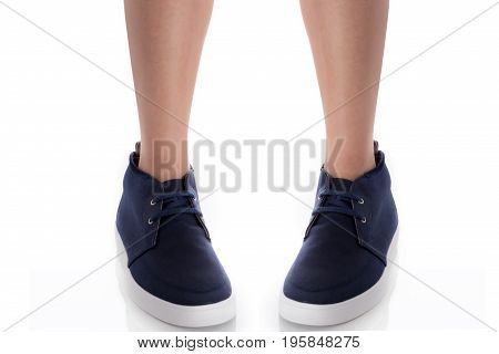 Man feet wearing blue fashion shoes in hipster style standing with front view Isolated on white background Men's Fashion concept.