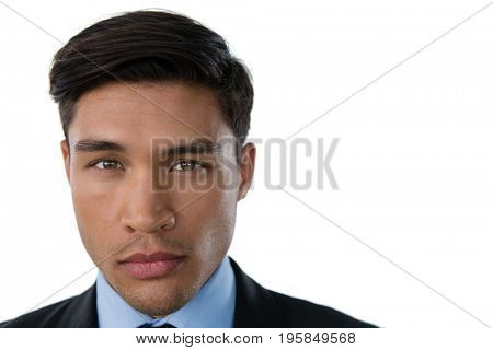 Portrait of businessman with raised eyebrow against white background