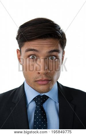 Portrait of young businessman with raised eyebrows against white background