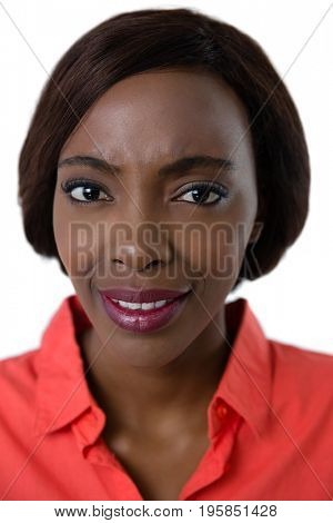 Portrait of confused young woman against white background