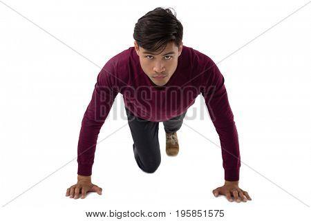 Portrait of businessman doing push ups against white background