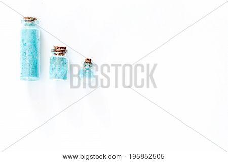 Sea cosmetics. Sea salt on white background top view.