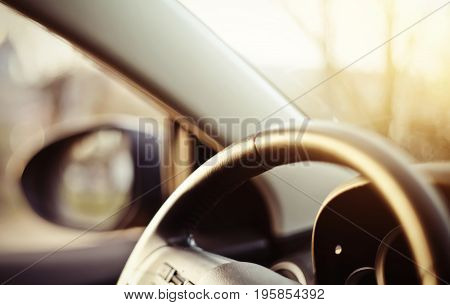 Blurred background with the dashboard of the car