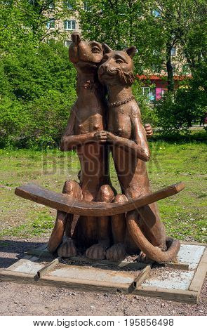 Sortavala, Republic of Karelia, Russia - June 12, 2017: AA bench in the form of the Art object -Dog and cat-.. Located in the square on the square of Kirov - the central square of the city.