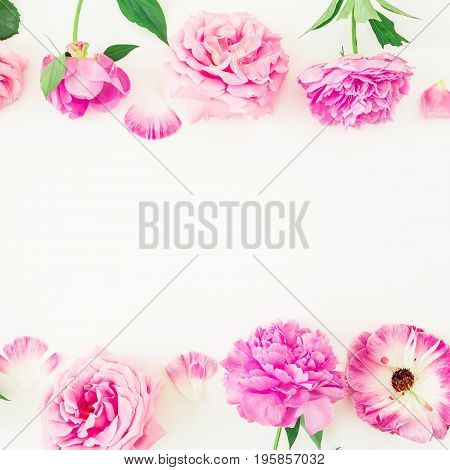 Frame of pink flowers and petals on white background. Floral lifestyle composition. Flat lay, top view.