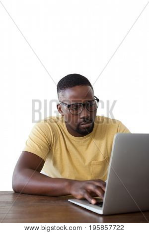 Man in spectacle using laptop against white background