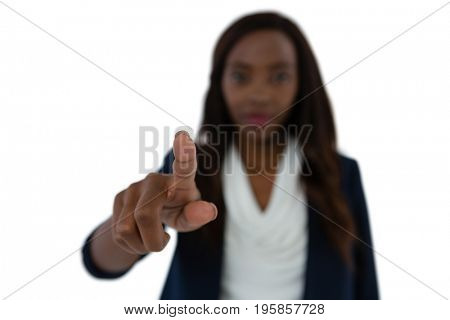 Toung businesswoman touching imaginary screen against white background