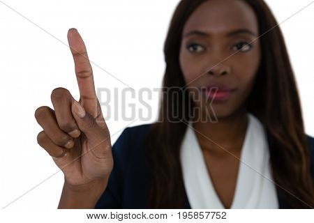 Close up of businesswoman touching imaginary screen against white background