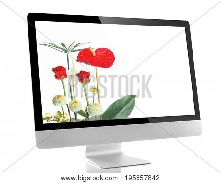 Modern computer display with beautiful flowers on screen, white background