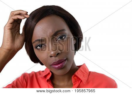 Portrait of confused woman against white background