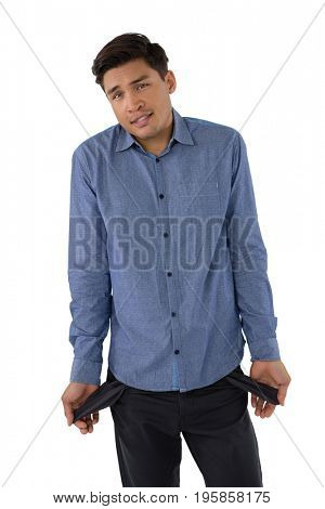 Portrait of businessman showing empty pockets