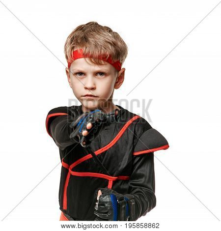 Portrait of young male ninja practicing fist kick