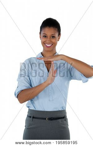 Portrait of smiling businesswoman making a timeout hand gesture