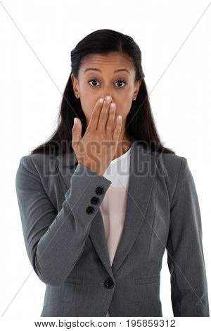 Portrait of surprised businesswoman covering her mouth with hand