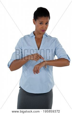 Portrait of businesswoman pointing at her wristwatch
