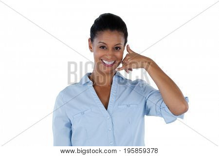 Portrait of businesswoman pretending to talk on a cell phone