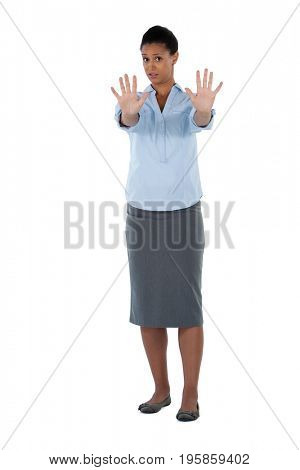 Portrait of businesswoman showing her hand while ignoring