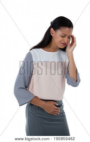 Businesswoman suffering from headache and stomach pain