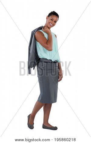 Portrait of businesswoman holding blazer against white background