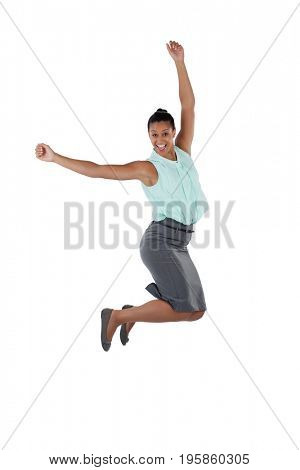 Excited businesswoman jumping in the air against white background
