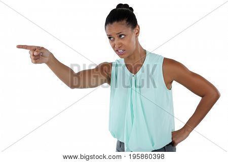 Angry businesswoman pointing against white background