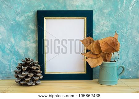 Autumn frame mockup blue and golden border tree branch with dry leaves in pitches pine cone concrete wall background rustic minimalist nordic style fall mood