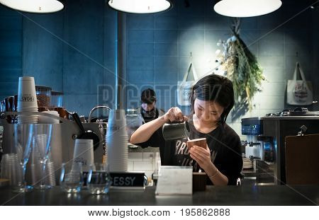 Tokyo, Japan - March 2,2017 : Undefined Japanese Barista Making Hot Latte In Modern Coffee Shop - To
