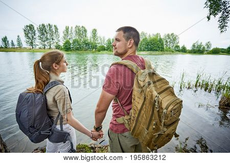 Two travelers near lakes, rivers