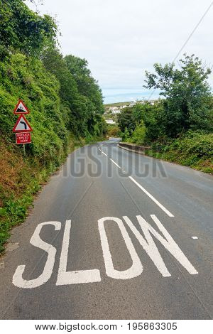 Slow sign on the road to Portreath, Cornwall England UK.