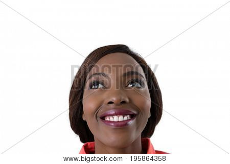 Close up of cheerful woman looking up against white background