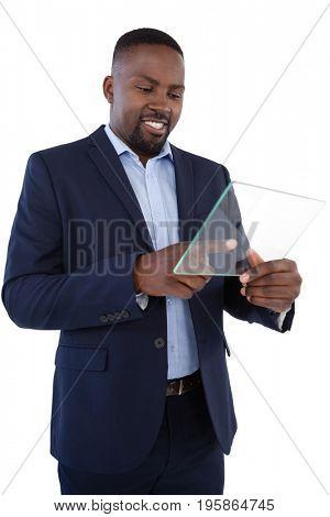 Smiling businessman using a glass digital tablet