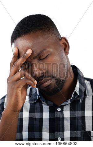 Tensed man against white background