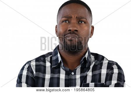 Thoughtful man standing against white background