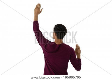 Businessman using imaginary invisible screen against white background
