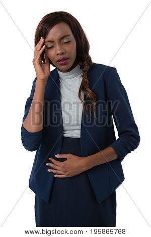 Businesswoman with head in hand suffering from stomach ache against white background