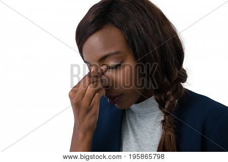 Close up of tired businesswoman against white background