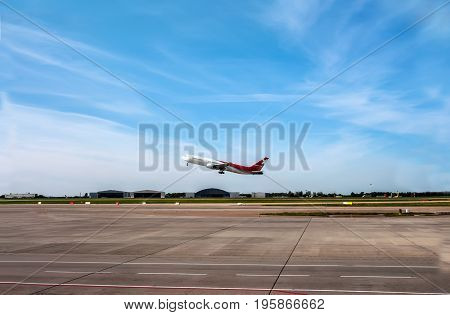 The plane was about to take off on the runway on the background of blue sky with Cirrus clouds. the horizontal frame. The horizontal frame.