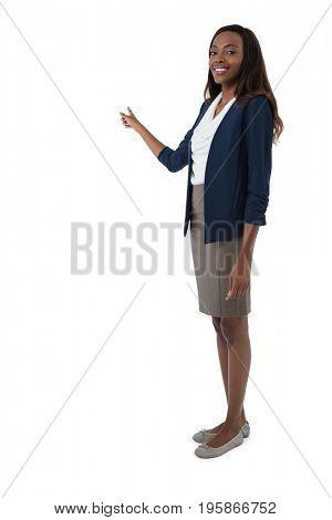 Full length portrait of businesswoman giving presentation against white background