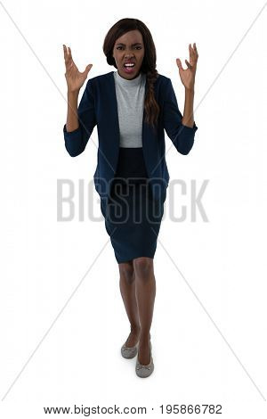 Full length portrait of frustrated businesswoman standing against white background