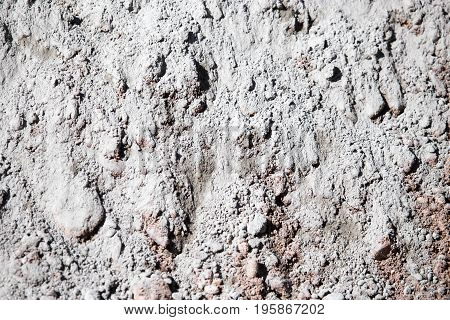 Mixture of sand and concrete as a background .